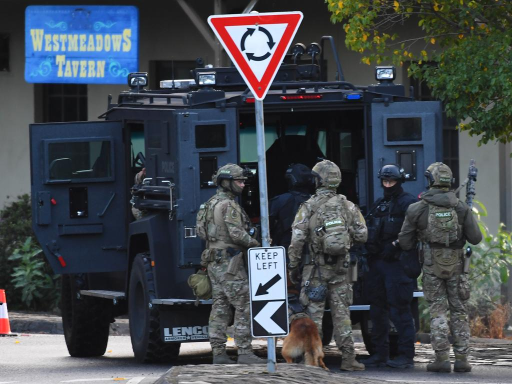 Armed police are seen outside the Westmeadows Tavern. Picture: AAP