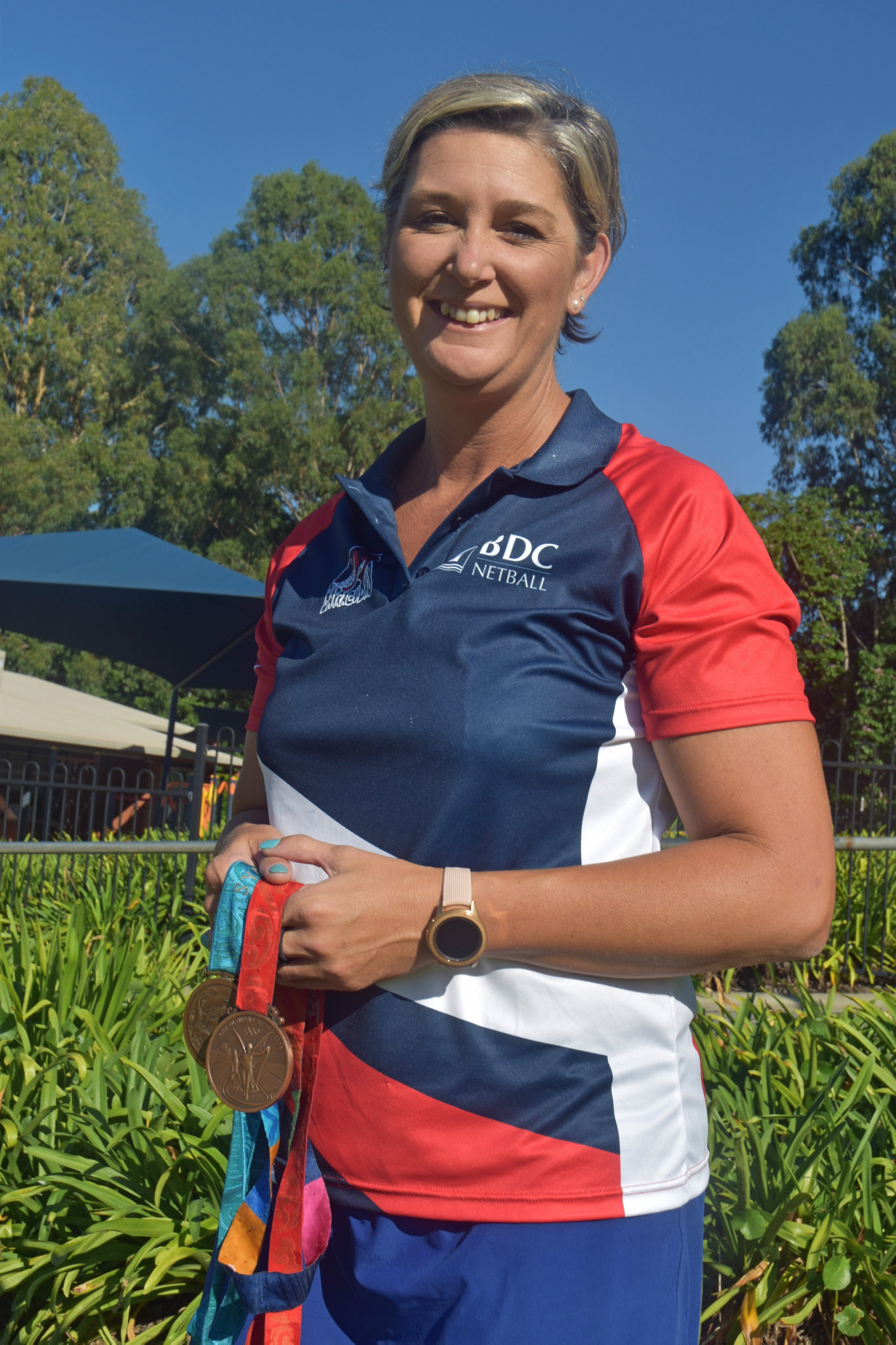 Three time Olympic softballer Nat Titcume with the medals she won in Sydney, Beijing and Athens.