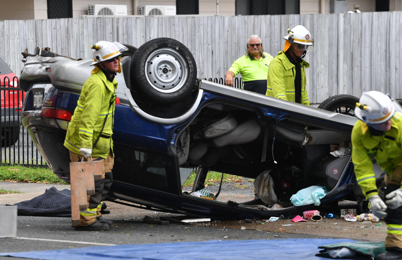Emergency services at the scene of the crash on Bridge Rd outside Mackay West State School. Picture: Tony Martin