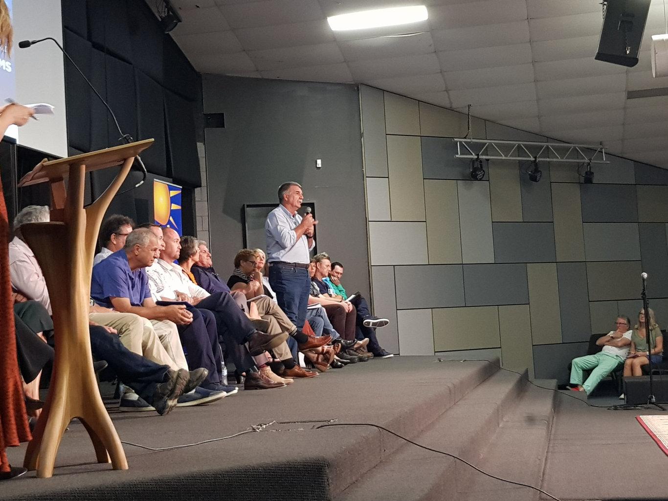 ON THE MIC: Joe Jurisevic addresses the crowd.