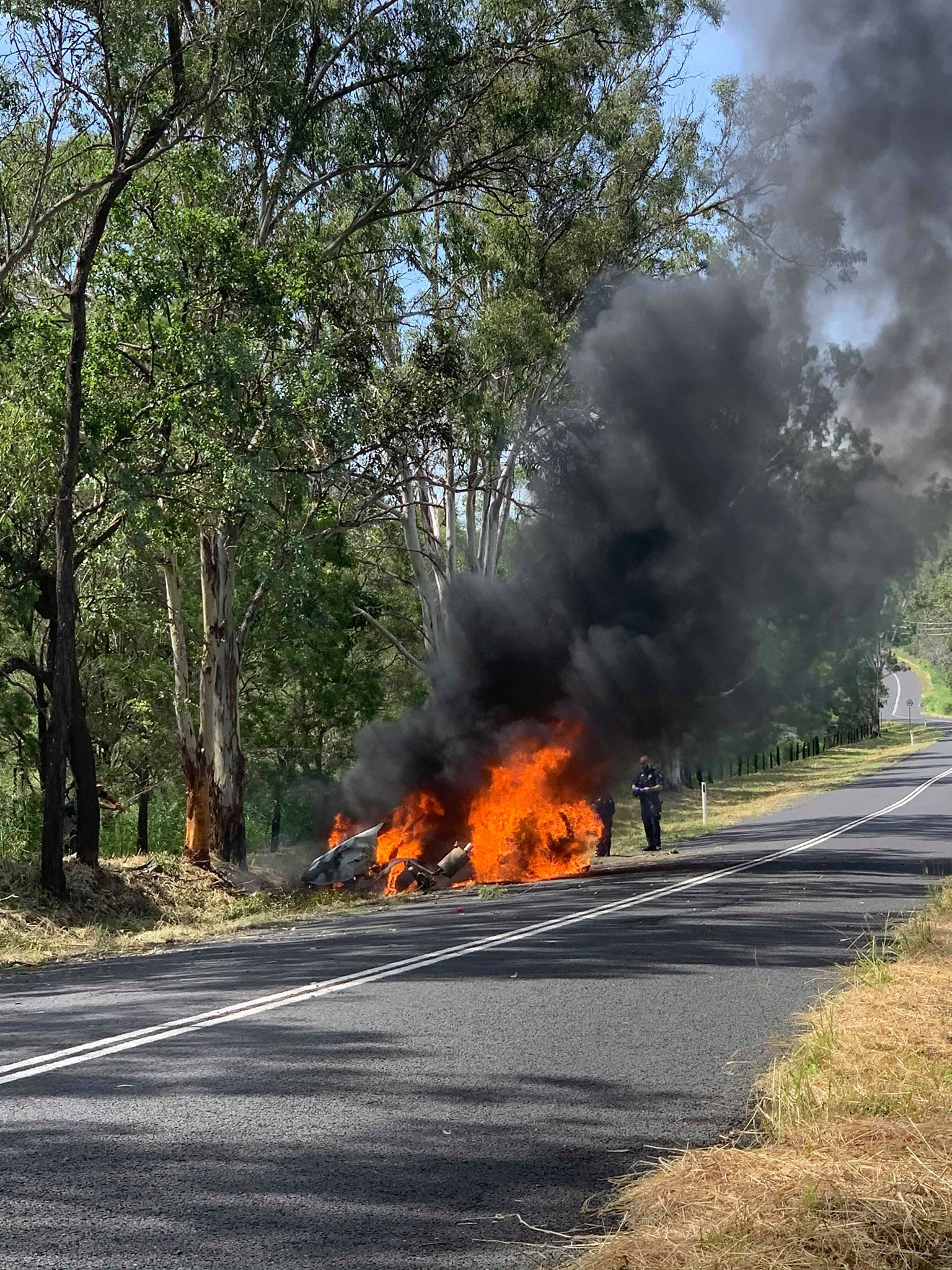 A woman died and car caught fire after a single-vehicle crash in to a tree this morning. Picture: Glen Zammit