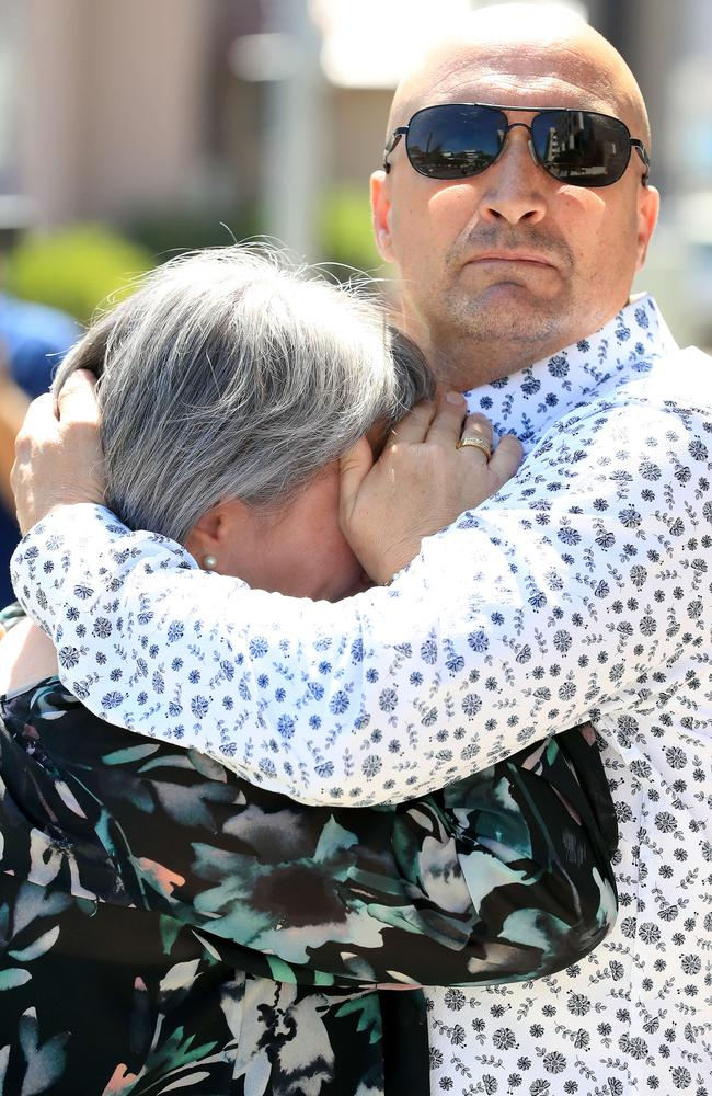 Donna and Miguel Baluskas embrace outside court after being ordered to pay damages to Tracey Brose. Picture: Adam Head