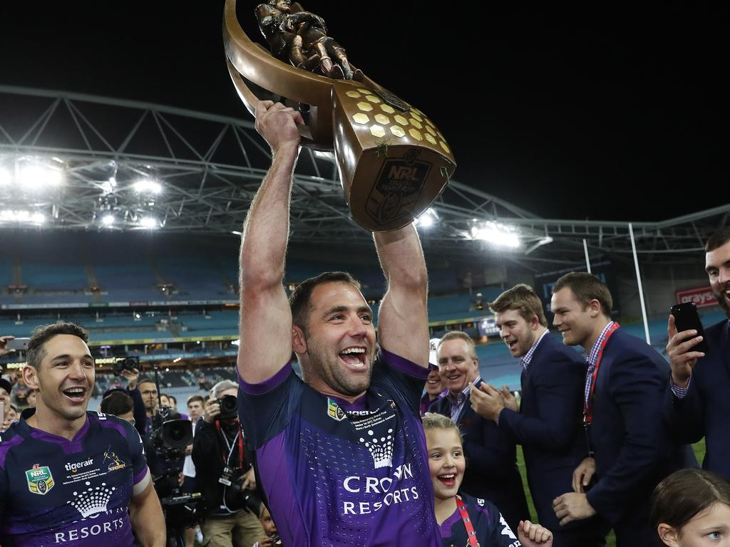Smith hoists the premiership trophy after Melbourne's victory in the 2017 grand final. Picture. Brett Costello