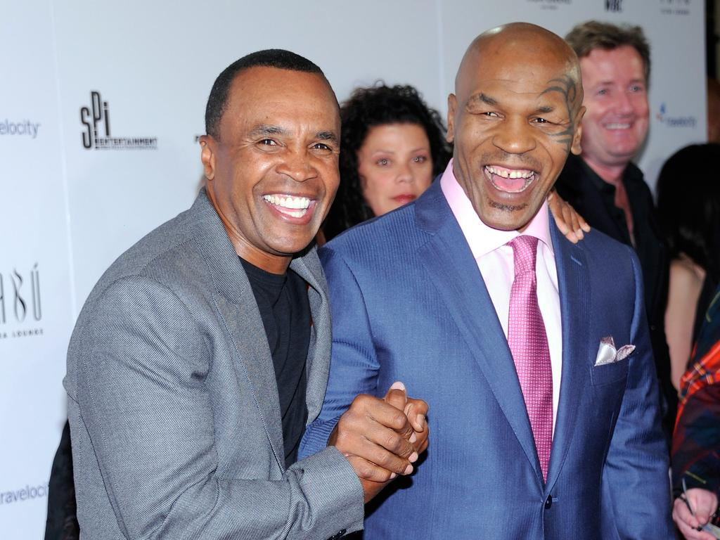 Former boxers Sugar Ray Leonard and Mike Tyson. Picture: Ethan Miller/Getty Images