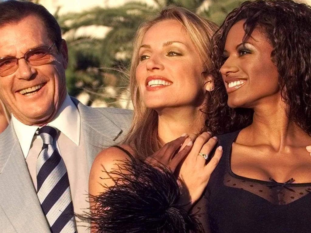 Roger Moore poses with (L-R) Caprice Bourret and Eva Halina in 1999 prior to Caprice dating Prince Andrew. Picture: Supplied