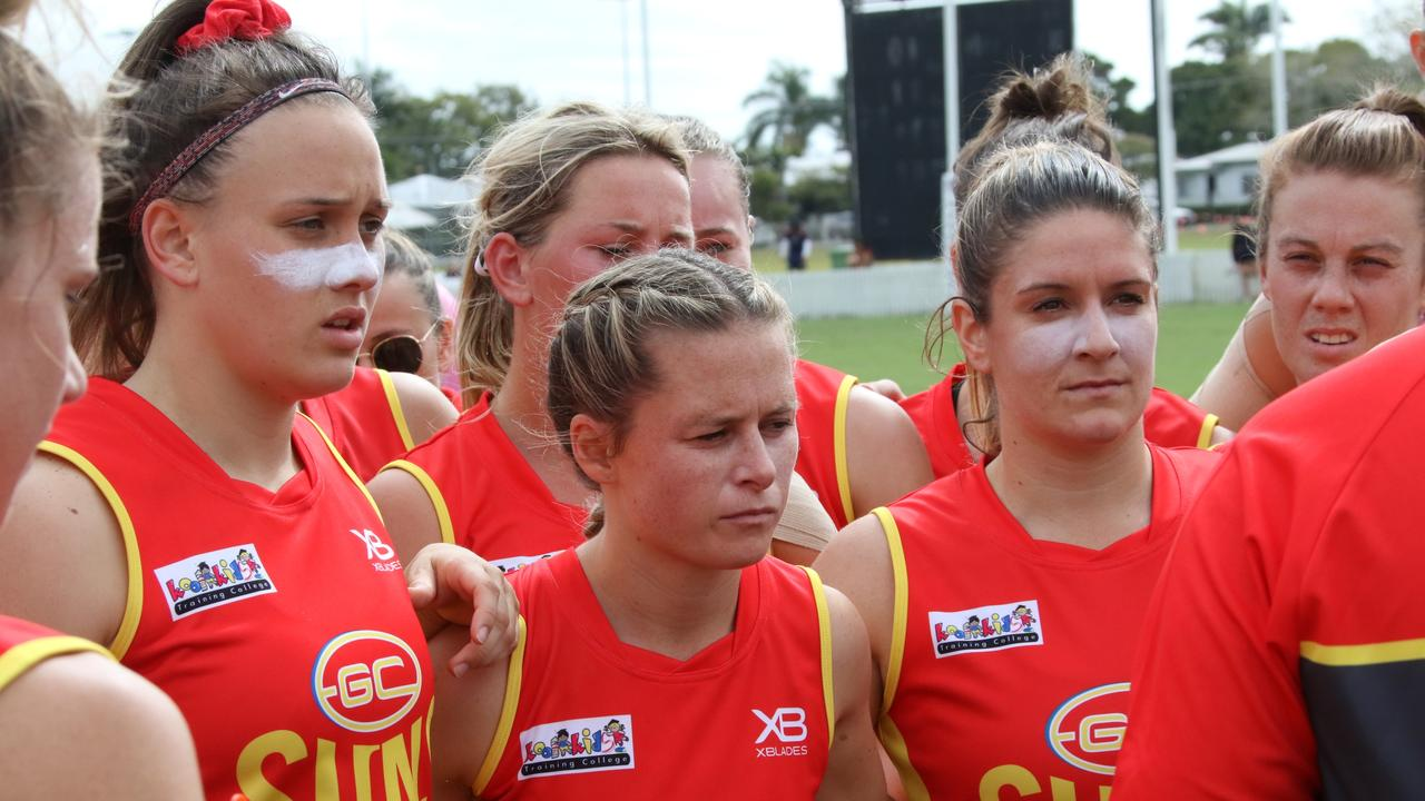 Ellie Hampson (left), Kate Surman (middle) and Maddy Roberts (right) during halftime of the QW Winter Series clash with the Brisbane Lions at Great Barrier Reef Arena last year.
