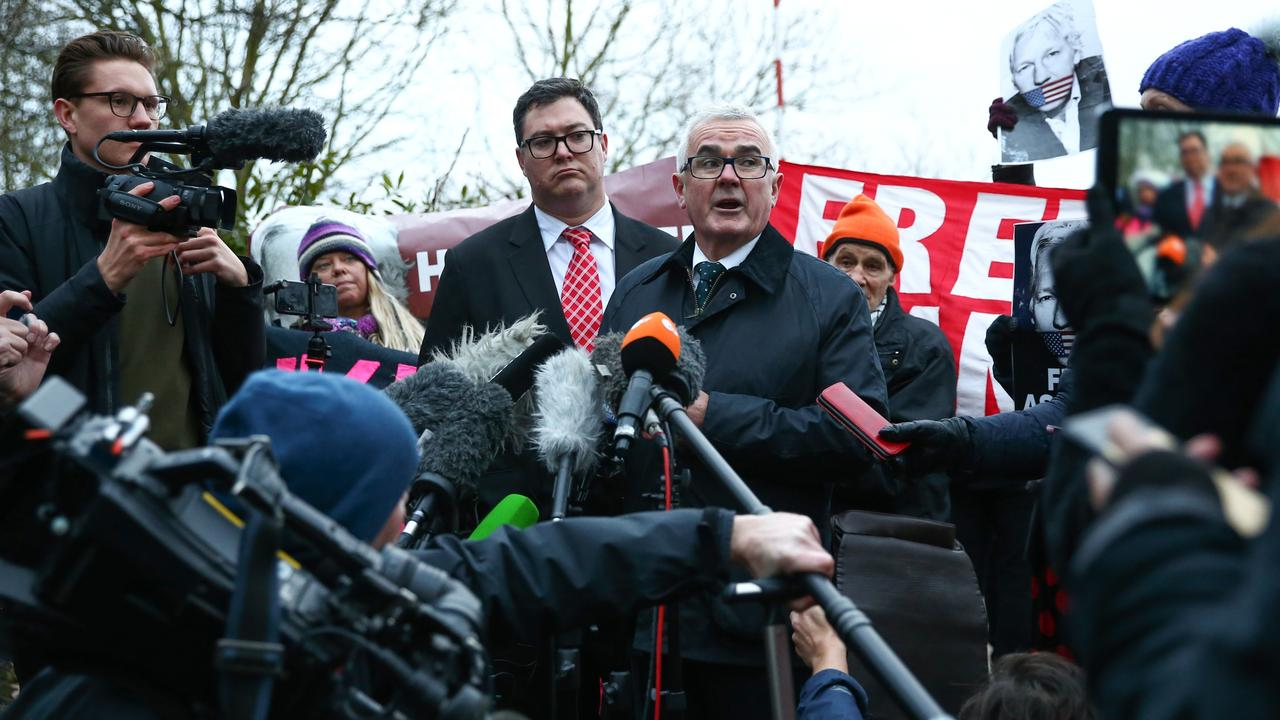 George Christensen, Australian Liberal National Party MP, and Andrew Wilkie, Independent MP, hold a press conference outside of Belmarsh prison after visiting WikiLeaks founder Julian Assange on Tuesday, 18 February. They are calling on the UK to block Assange's extradition to the US ahead of his hearing next week. Hollie Adams/News Corp Australia