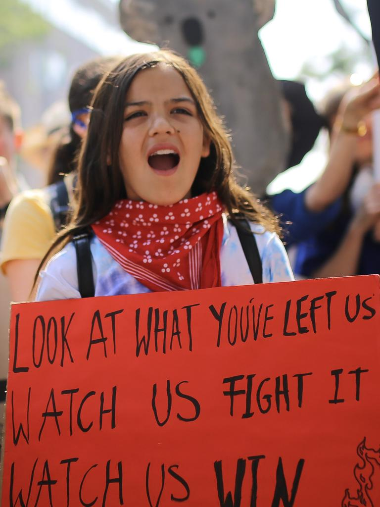 A girl protests outside Kirribilli House in Sydney. Picture: AAP Image/Steven Saphore