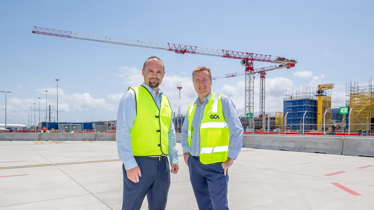 Lendlease Building Queensland General Manager Brad Protheroe (above left with Queensland Airports Ltd's Chris Mills) said there were still opportunities for local tradies to have a go.