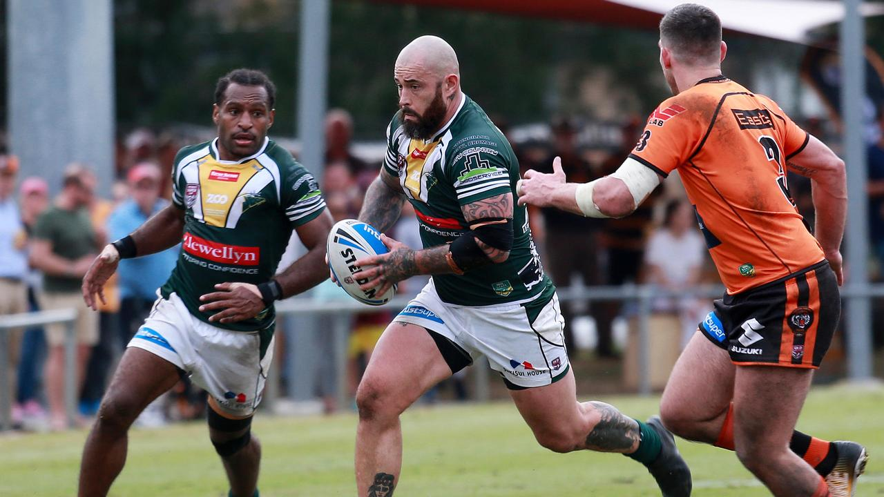 Ipswich Jets captain Nat Neale bursts through. PIcture: Sarah Marshall/AAP/Image