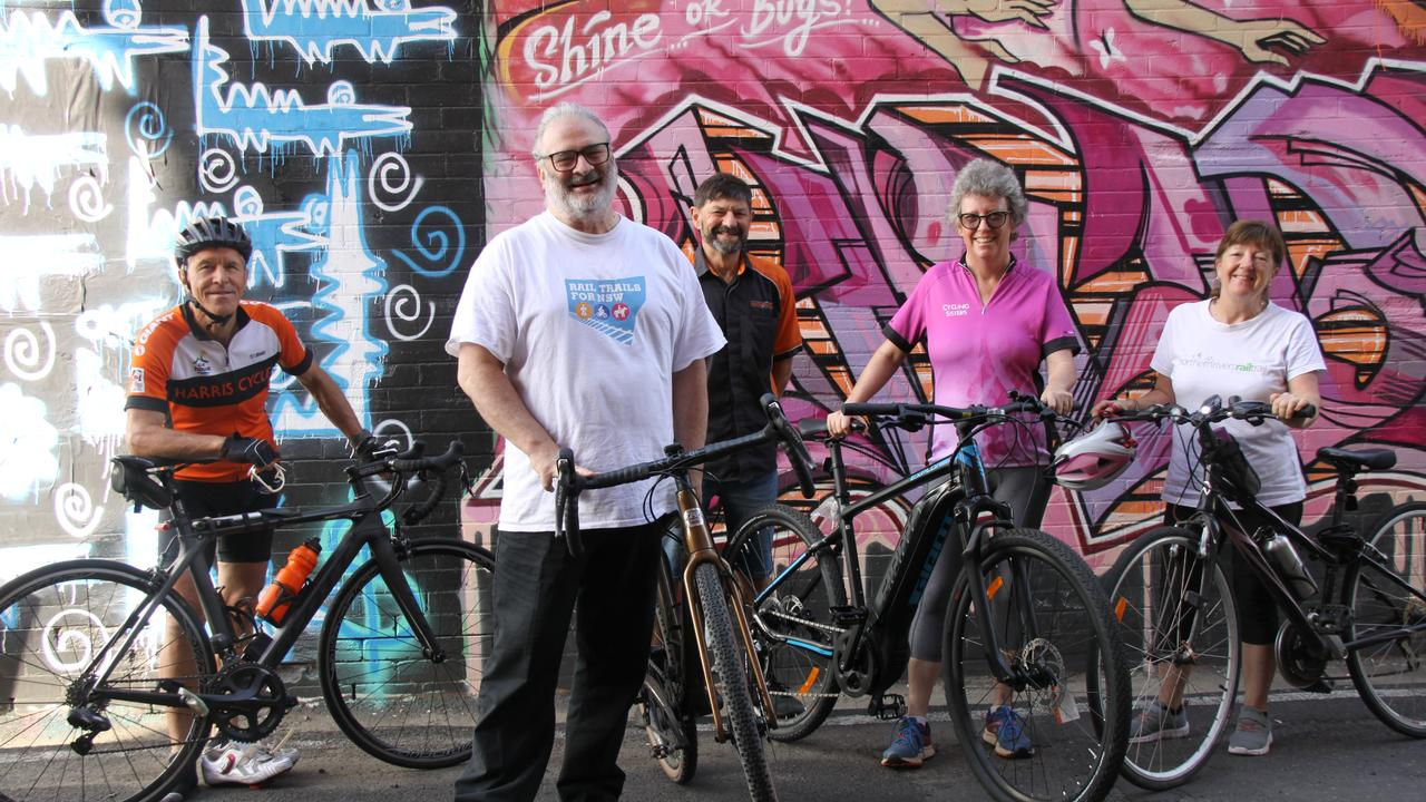 TRAIL MIX: In town to update Lismore City Council about of the Northern Rivers Rail Trail, Rail Trails for NSW Deputy chair Tim Coen (in white) also met with supporters L-R Rick Stewart, Haris Cycles owner Darryl Pursey, Cycle Sisters Sue-Ellen Shortiss and Glenys Ritchie about the benefits the project will bring the region.