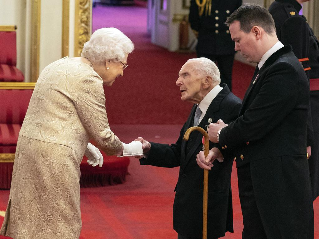 The Queen wore gloves during an investiture ceremony at Buckingham Palace, something she hasn't done since 1954. Picture: AP