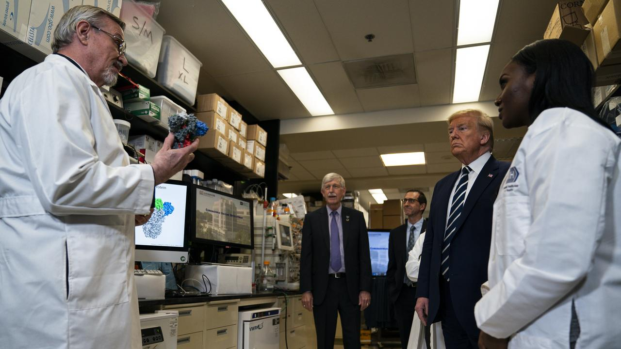 Mr Trump tours the Viral Pathogenesis Laboratory at the National Institutes of Health. Picture: AP