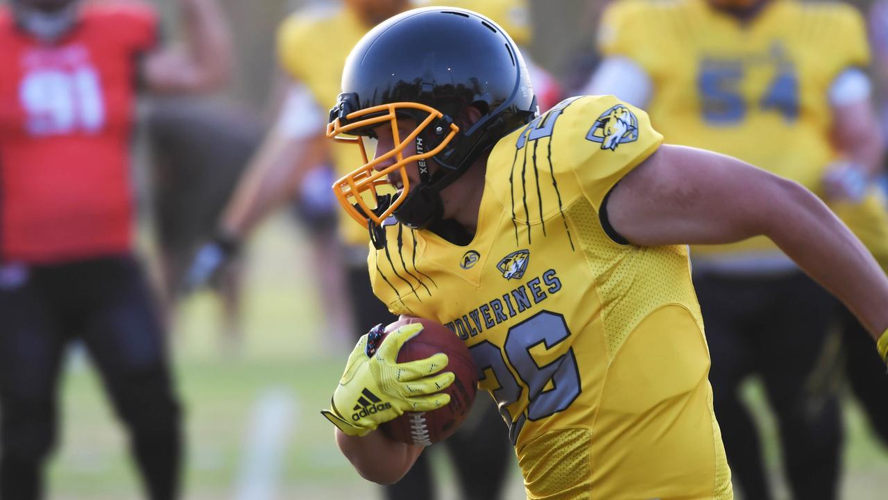 Rockhampton Wolverines player Josiah Drane charges into action. Picture: Allan Reinikka