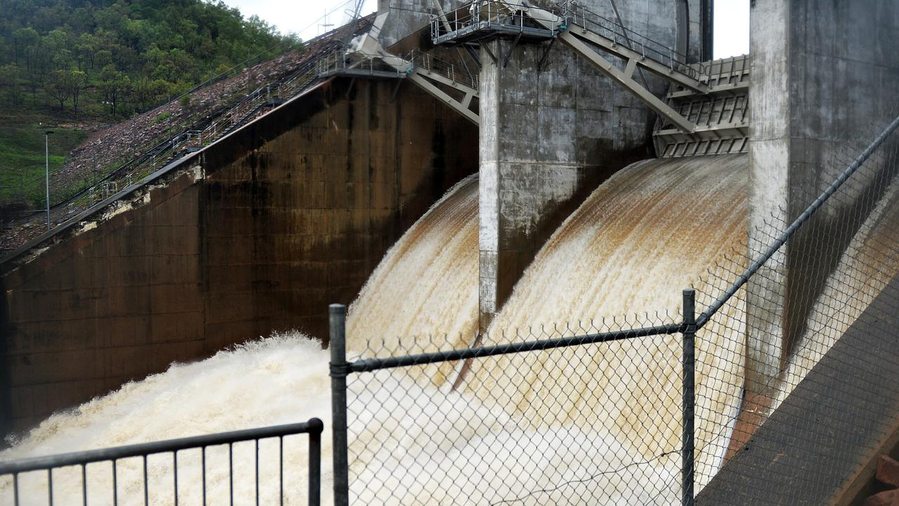 Ross River Dam during the 2019 flood. A James Cook University thesis says an optimised dam operating system could have prevented flooding to more than 3000 homes. Picture: Alix Sweeney