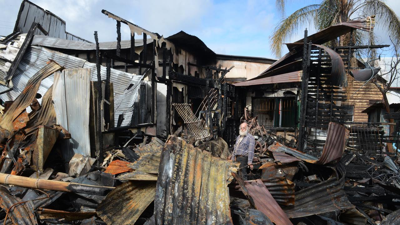 Michael Balderstone trying to save a few items from the museum after the devastating fire in Cullen street in Nimbin. The fire destroyed The Rainbow cafe, The Nimbin Museum, Tribal Magic and BringaBong shops. Photo : Mireille Merlet-Shaw/The Northern Star