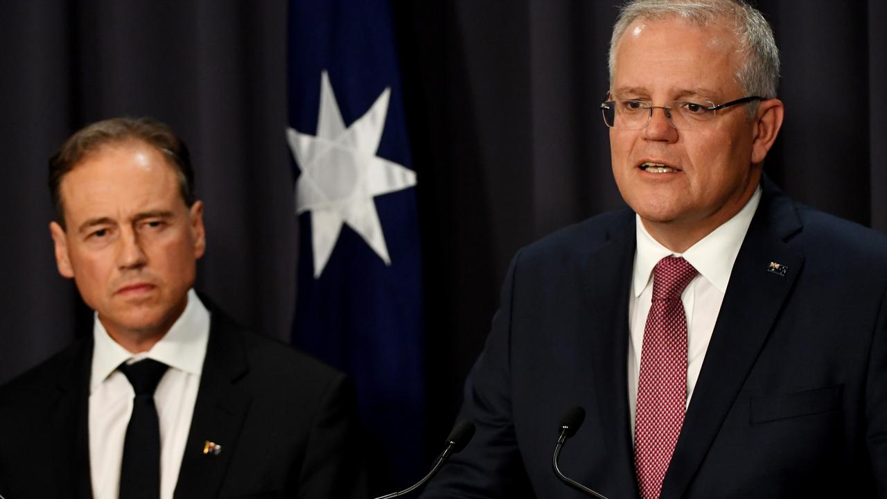 Australian Health Minister Greg Hunt (left) and Australian Prime Minister Scott Morrison are reportedly in talks about further travel restrictions. Picture: Tracey Nearmy/Getty Images.