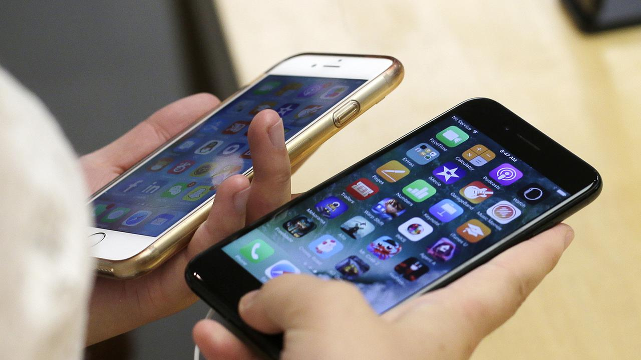 Previously iPhones were restricted to running iOS, until now. Picture: AP Photo / Kiichiro Sato