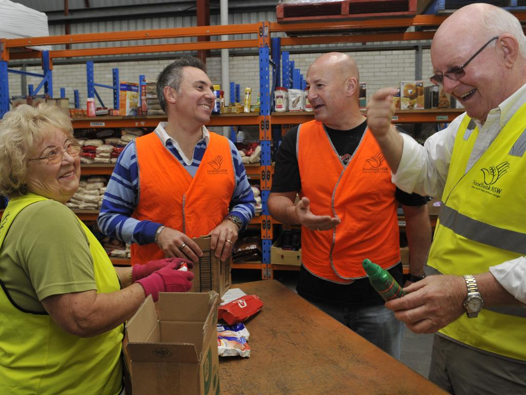 volunteer Bozena Wyrzuk, Guy Zangari, John Robertson & Gerry Anderson. work at the Foodbank in Wetherill Park.