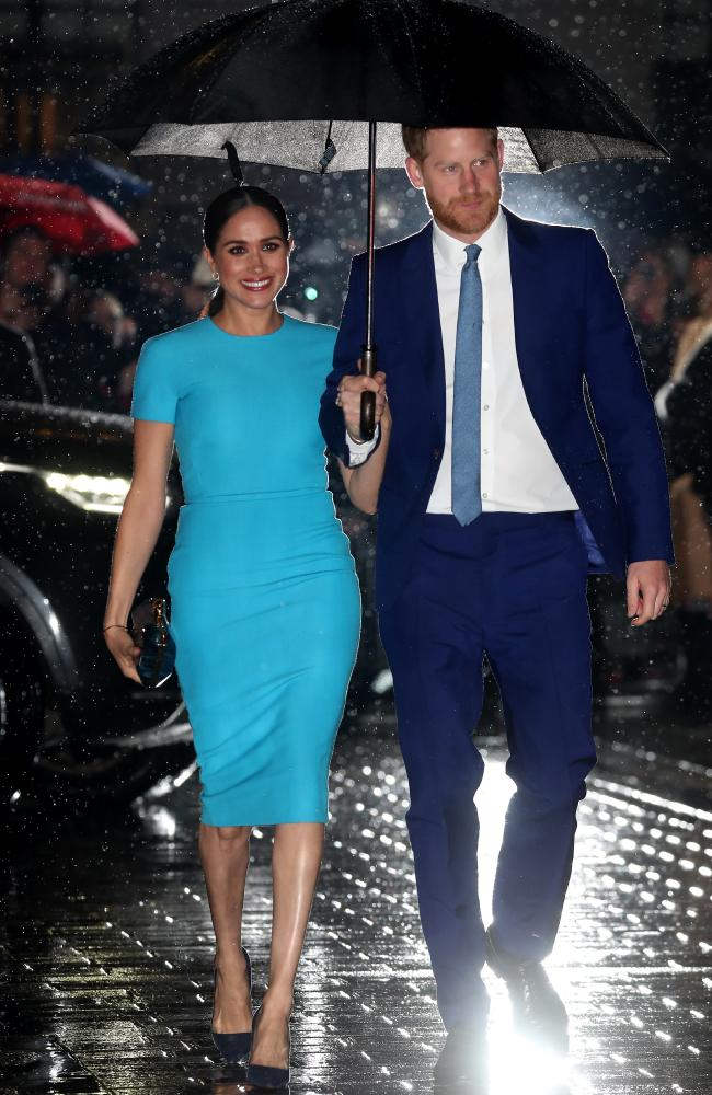 The royals carried an umbrella as they walked hand-in-hand. Picture: Chris Jackson/Getty Images Source:Getty Images