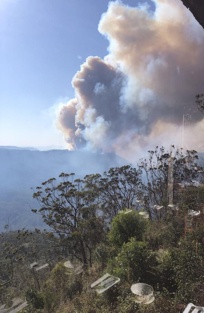 The fires as seen from the dining room of Binna Burra Lodge before evacuation. Picture: Luke Beyer