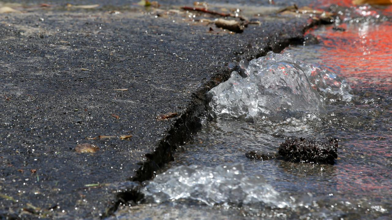 An image of water running from a burst water main.