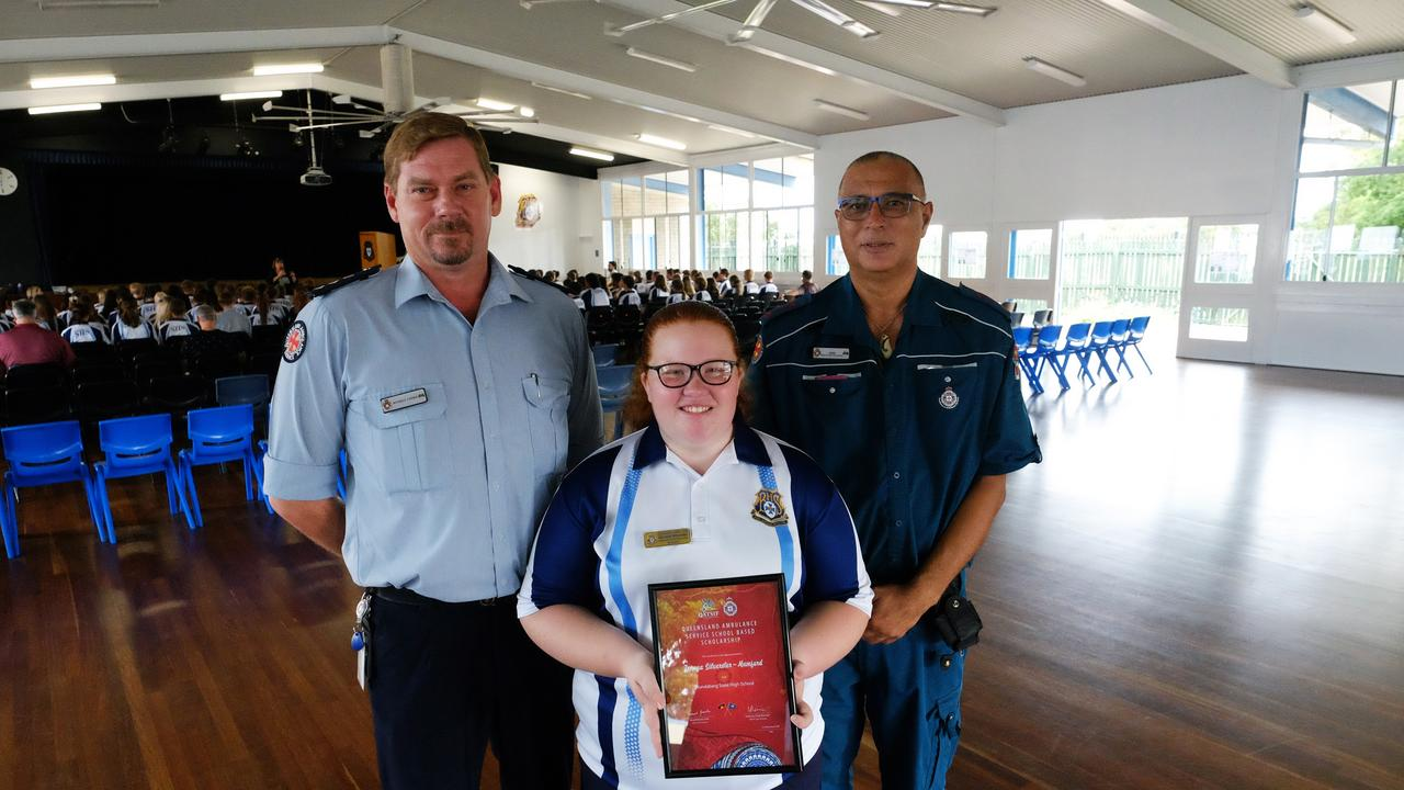 Bundaberg State High Schools Zenaya Silvester-Mumford with the Queensland Ambulance Service School Based Scholarship award presented by QAS Wide Bay Chief Superintendent Russell Cooke and paramedic Rod Macdonald.