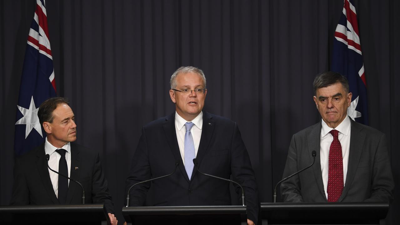 Australian Health Minister Greg Hunt, Australian Prime Minister Scott Morrison and Australia's Chief Medical Officers Professor Brendan Murphy provide an update on the deadly virus. Picture: AAP Image/Lukas Coch