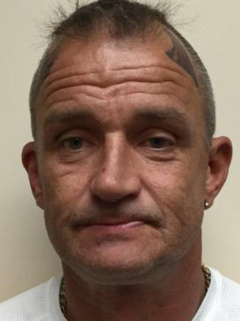 Mark Pollard had distinctive horns tattooed on his head.