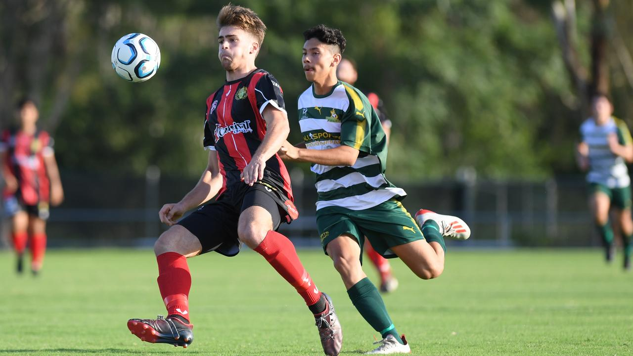 Western Pride striker Jacob Advaney works hard chasing a Mitchelton defender in last weekend's QPL match at the Briggs Road Sporting Complex. Picture: Rob Williams