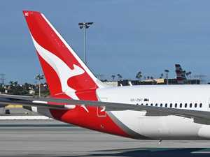 Qantas cuts flights amid virus outbreak