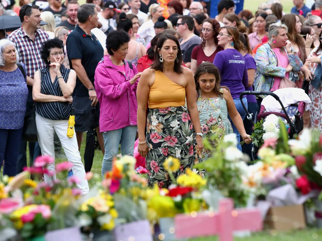 Mourners lay flowers during a vigil to remember murdered mother, Hannah Clarke and her three children at Bill Hewitt Reserve in Camp Hill on February 23, 2020 in Brisbane. Picture: Jono Searle/Getty Images