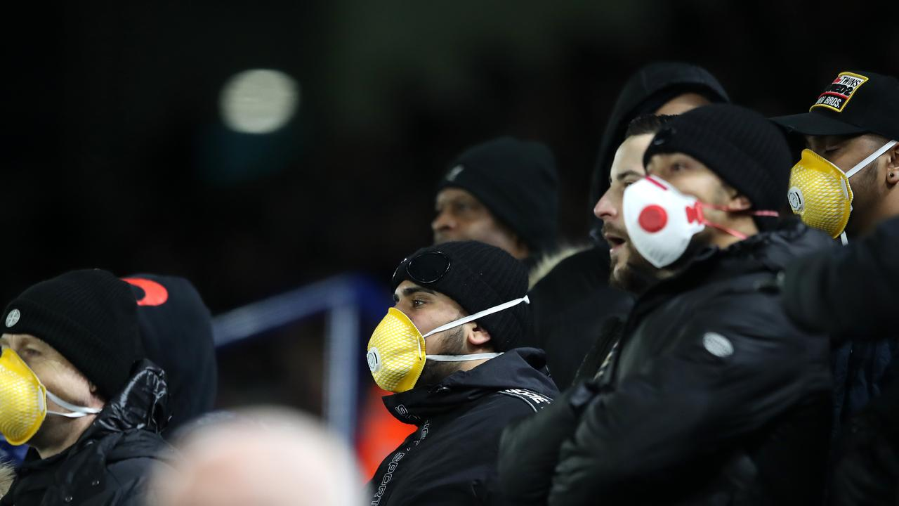 Fans wear face masks during the FA Cup Fifth Round match between Leicester City and Birmingham City at The King Power Stadium this week in Leicester, England. Picture: Alex Pantling, Getty Images.