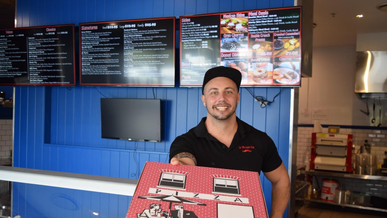 OPEN FOR BUSINESS: Co-owner of Mr Mozzarella Lismore Cameron Austin in the Ballina shop at Ballina Central Shopping Centre.