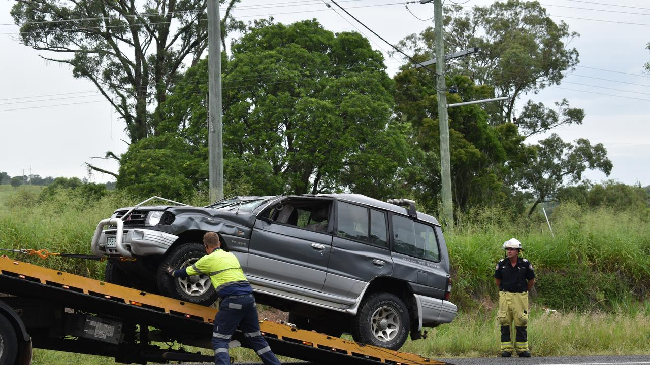 Two people were when a car rolled on the Bruce Highway near Bells Bridge on Friday morning, causing highway traffic delays.