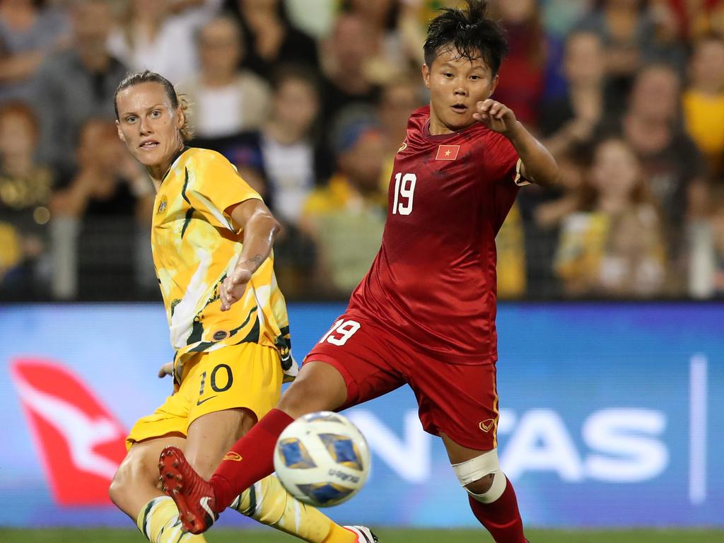 Nguyen Thi Bich Thuy of Vietnam contests the ball with Emily Van Egmond of the Australian Matildas during the Women's Olympic Football Tournament Play-Off match. Picture: Tony Feder/Getty Images