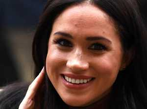 Meghan all smiles on return to London
