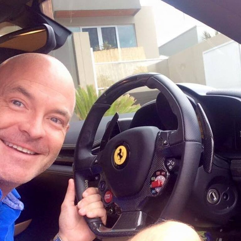 Sunshine Coast businessman Gordon Smith behind the wheel of a Ferrari.