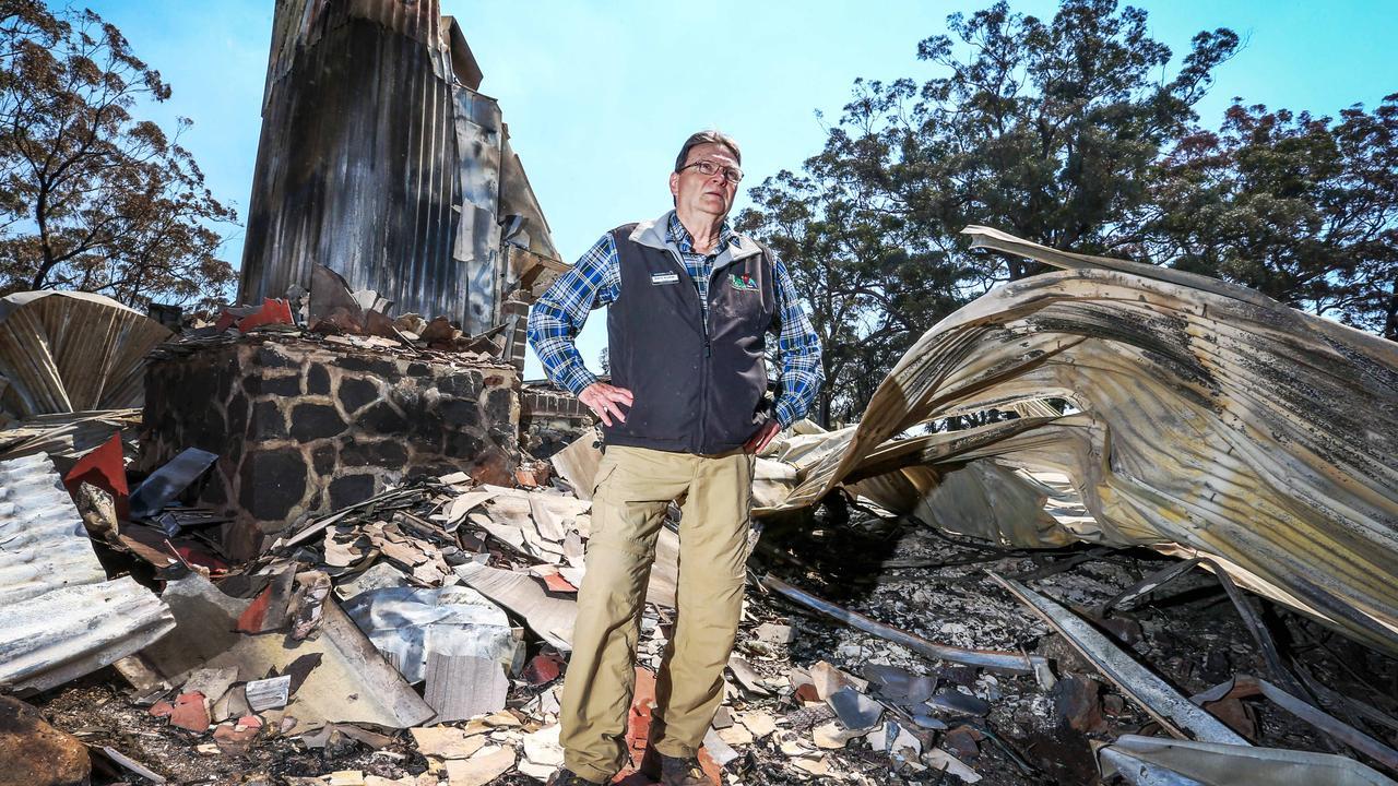 """""""When I woke up, it was gone."""" Steve Noakes in the wreckage of Binna Burra Lodge. Picture: Nigel Hallett"""