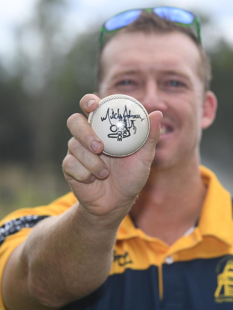 Kelvin Cochrane with the Mitchell Johnson signed ball which was one of the top items auctioned.