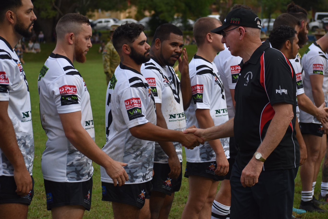 Governor General David Hurley shakes hands with the Bellingen Dorrigo Magpies prior to kick off against the Australian Army Thunder in the Sgt. Matthew Locke Memorial match at Bellingen.