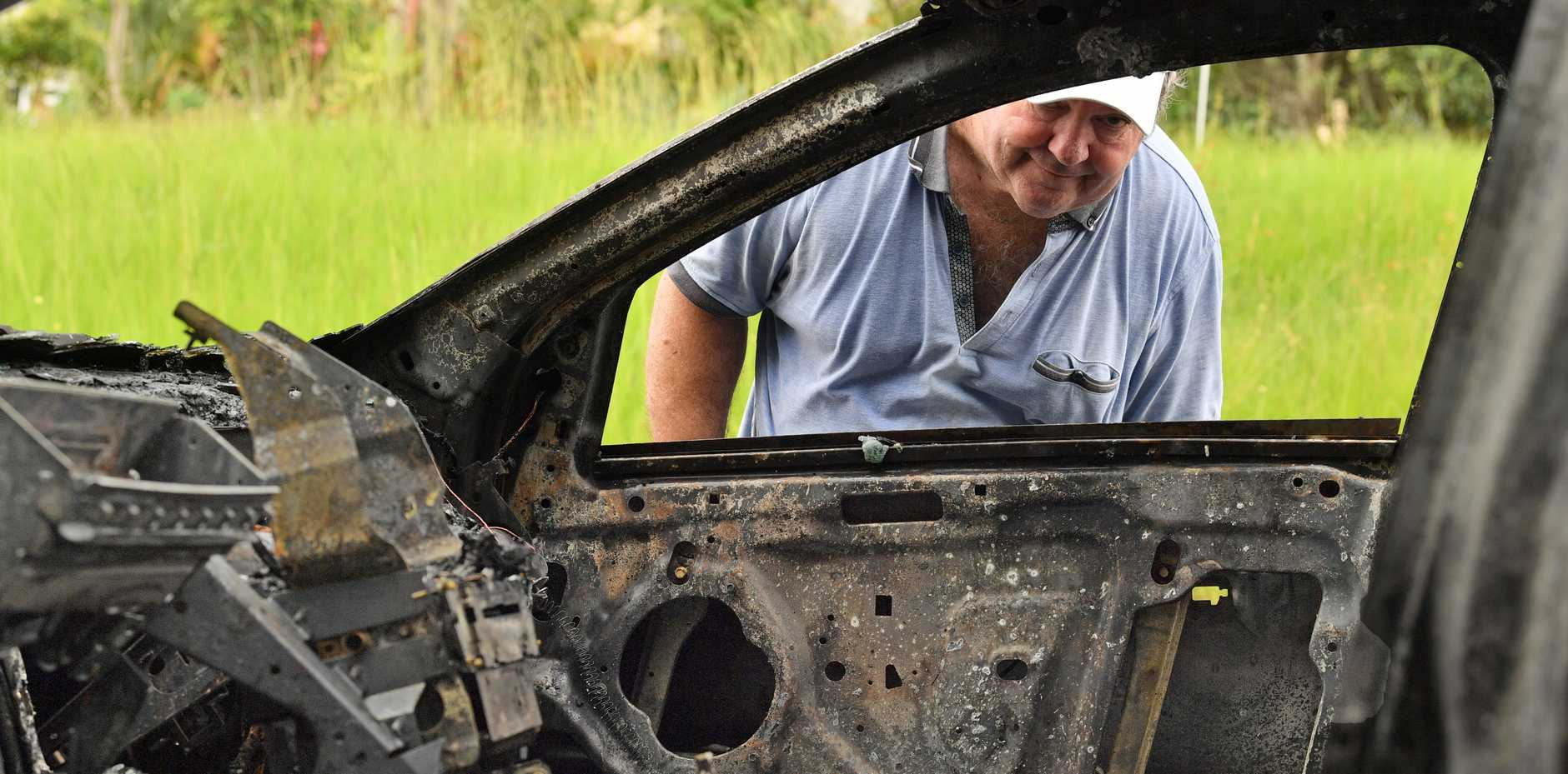 Ron Bailey with his destroyed Ford Falcon ute which went up in flames this morning
