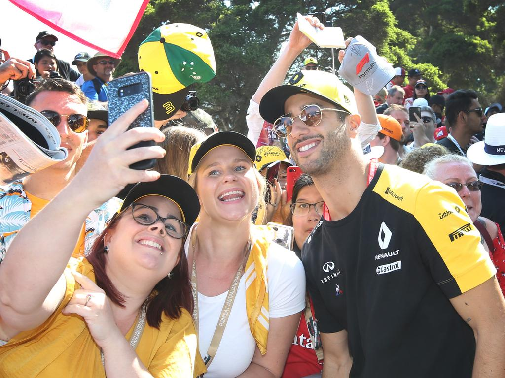 Ricciardo signs autographs and takes selfies with fans at Albert Park last year.
