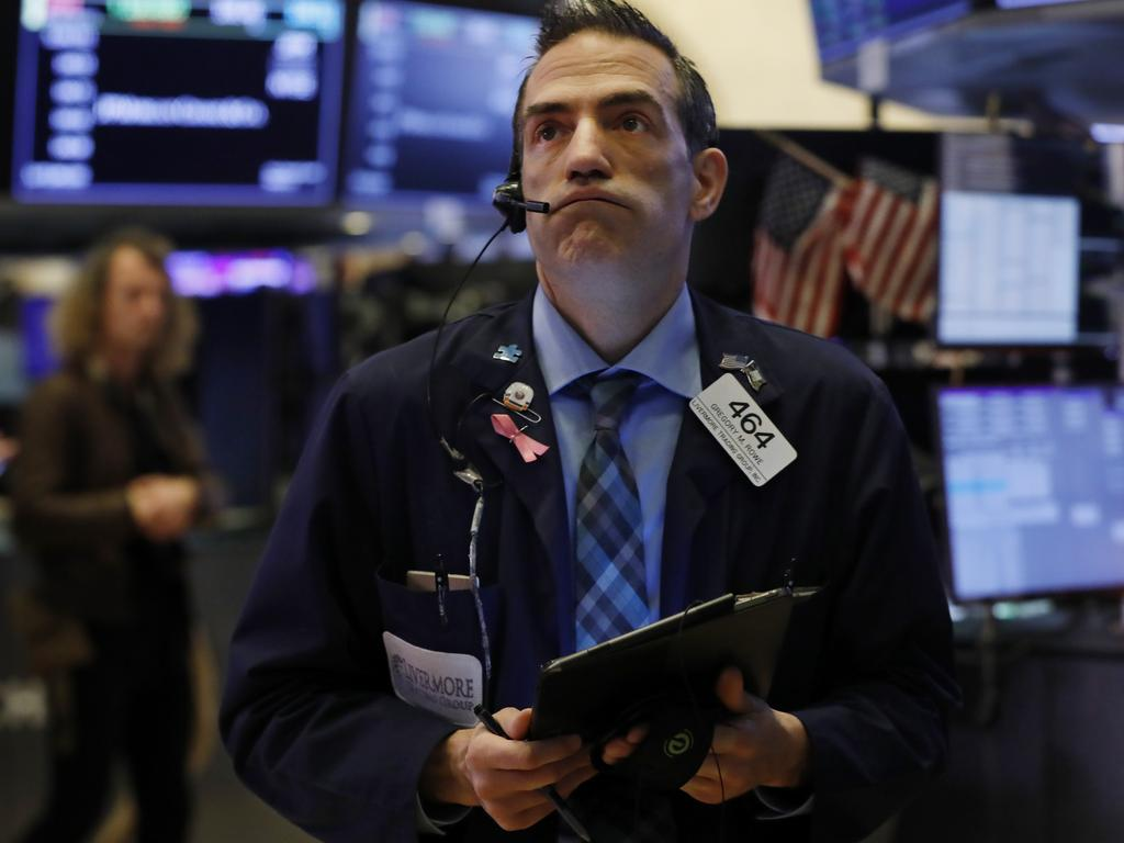 Trader Gregory Rowe works on the floor of the New York Stock Exchange as markets drop again. Picture: AP