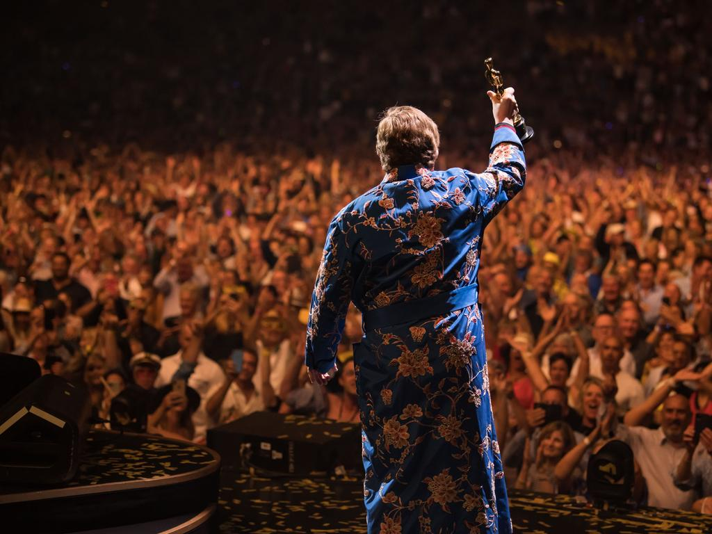 Elton John in New Zealand for more shows... and bringing that Oscar with him! Picture: Ben Gibson