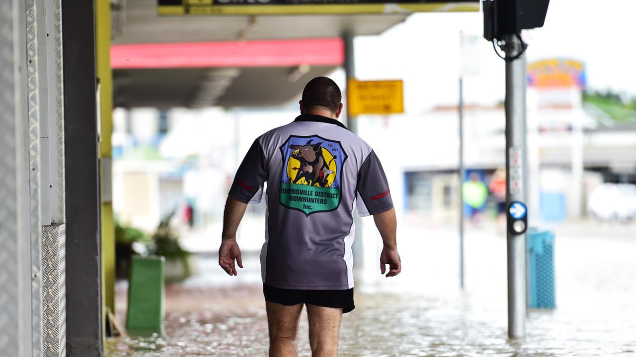 Owner of Redback Archery and Bowhunting Supplies Scott Murray on the flooded street. Picture: Alix Sweeney