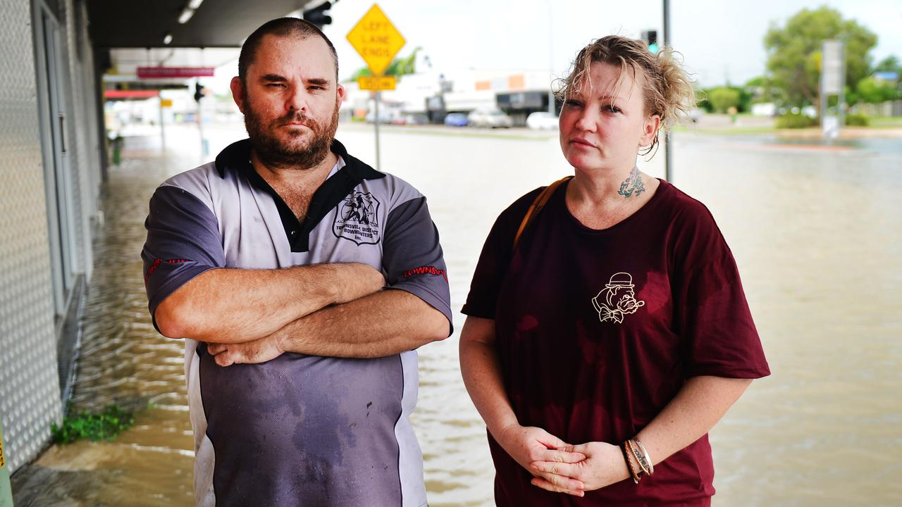 A water main has burst on the corner of Bowen Rd and Charters Towers Rd. Owner of Redback Archery and Bowhunting Supplies Scott Murray and Owner of Gentleman Jones Cassandra Jones. Picture: Alix Sweeney