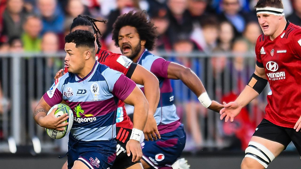 Reds centre Hunter Paisami eludes Crusaders winger Leicester Faingaanuku during last Friday's clash in Christchurch. AAP Image/Photosport NZ: John Davidson