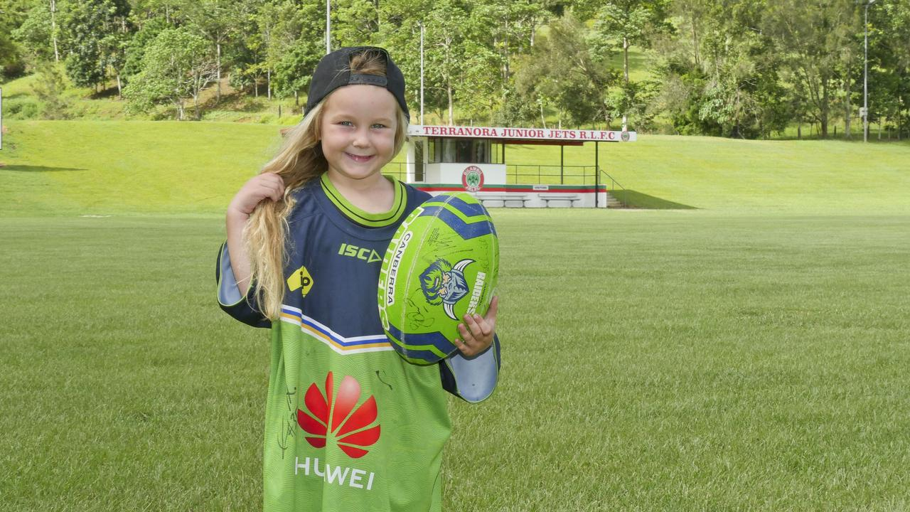 Bilambil Jets Junior Rugby League player and Canberra Raiders super fan Nina Clarke, 4, will be shaving off her hair for cancer at her first rugby match later this month. She is wearing a training shirt her hero and favourite player Charnze Nicoll-Klokstad gave her when he heard about her World's Greatest Shave event.