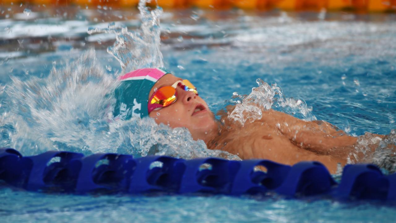 Ty Lynch in the 100m backstroke. Picture: Allan Reinikka